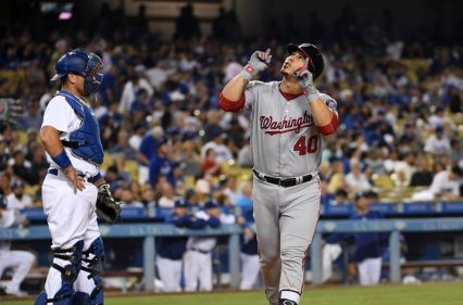 Jun 22, 2016; Los Angeles, CA, USA; Washington Nationals catcher Wilson Ramos (40) celebrates after hitting a solo home run as Los Angeles Dodgers catcher A.J. Ellis (17) reacts in the eighth inning at Dodger Stadium. Mandatory Credit: Kirby Lee-USA TODAY Sports