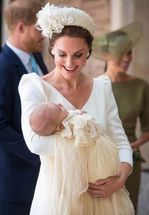Mandatory Credit: Photo by Dominic Lipinski/AP/REX/Shutterstock (9747690a) Kate, Duchess of Cambridge carries Prince Louis as they arrive for his christening service at the Chapel Royal, St James's Palace, London Britain Royals, London, United Kingdom - 09 Jul 2018